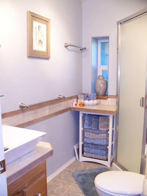 Your bathroom, clean and fully stocked for your stay.