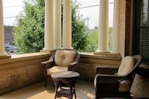 The front porch of the Bab's, in the main entry, facing the exciting street life!