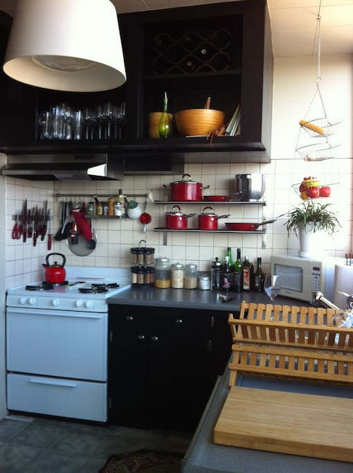 The fully-stocked kitchen has a gas stove, dishwasher, disposer and all the tools for cooking.