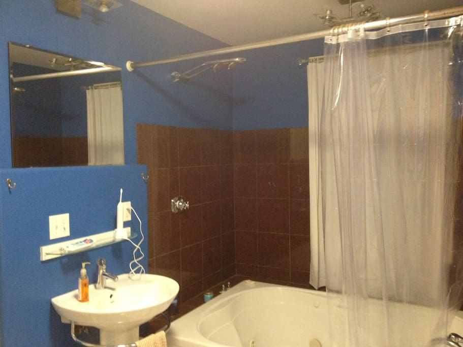 The 2nd floor bathroom. It includes 4 shower heads and a jacuzzi. Shared with one roommate.