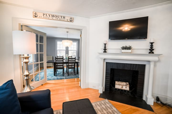 """Living room with view into dining room. The living room has a 42"""" cable TV and high-speed internet which is accessible throughout the house. Enjoy comfortable, cozy seating for all your guests."""