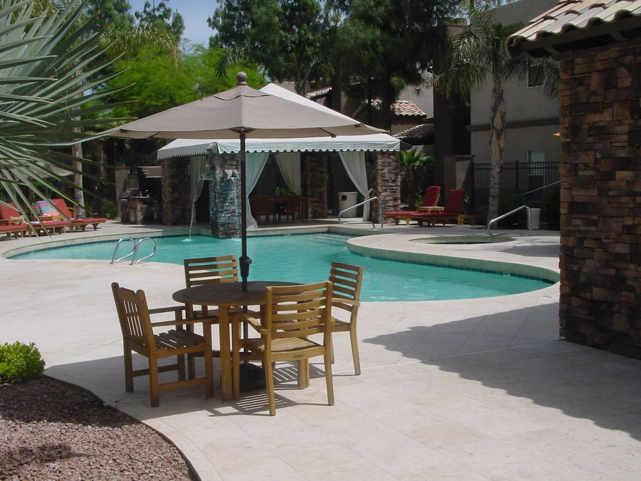 North Scottsdale Condo overlooking lush green and palm tree including swimming pool.