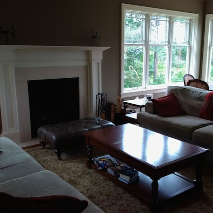 Large great room with huge picture windows and extra large fireplace.