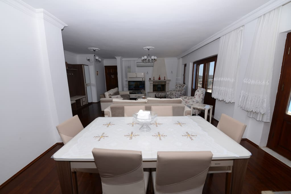 Big table next to the fully furnished kitchen