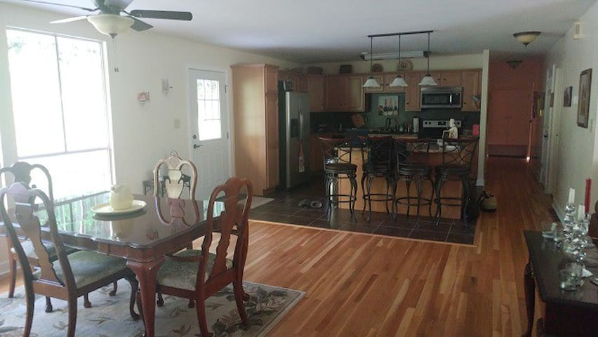 Bright, open kitchen/dining area is open to all guests