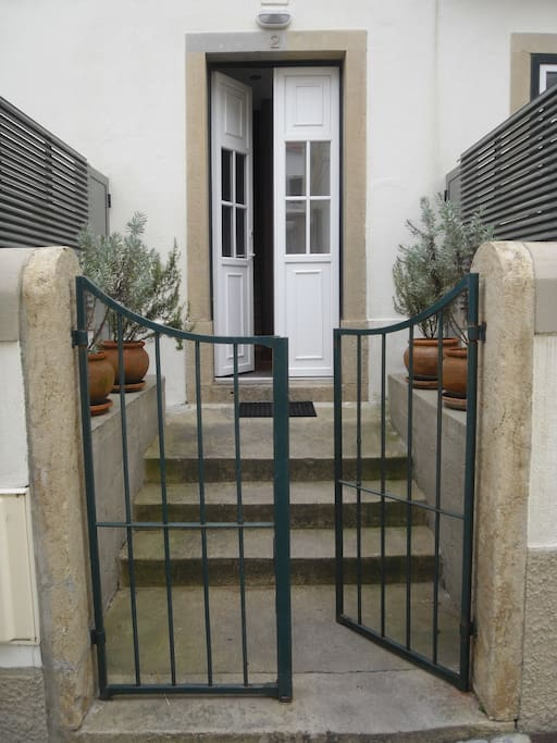 3 - Entry, directly from outside common area, overlooking the fences of the outside private patios
