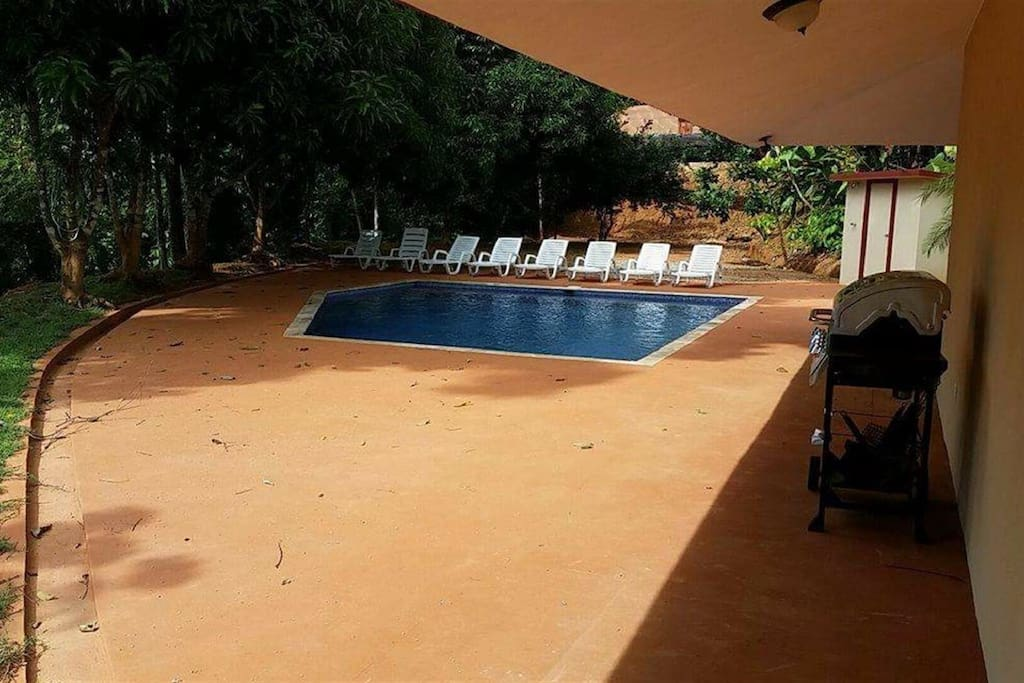 Large Pool Patio with BBQ, Lounge Chairs, & outdoor shower