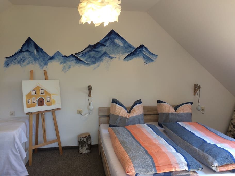 Beedroom with moutain paint