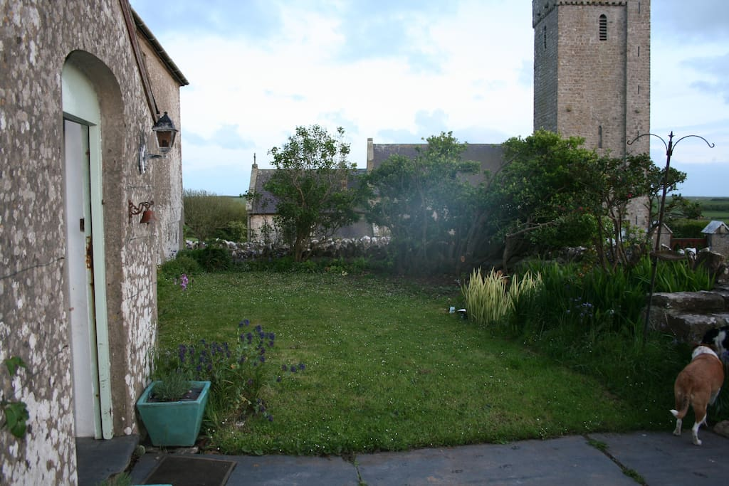Our front door & some of the garden, with the church we use as a landmark - you can see it for miles!