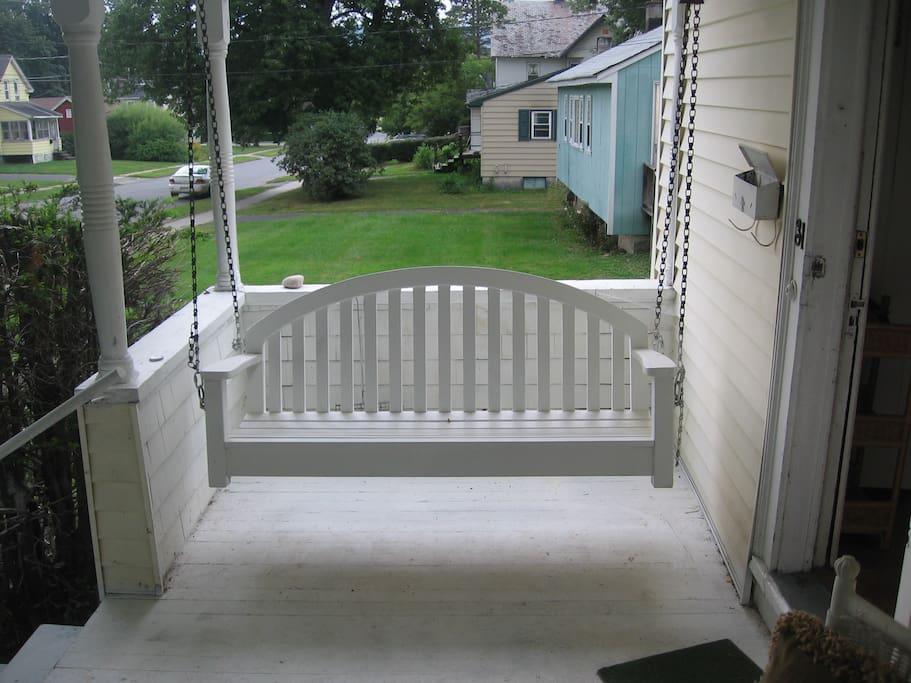 Swinging front porch swing
