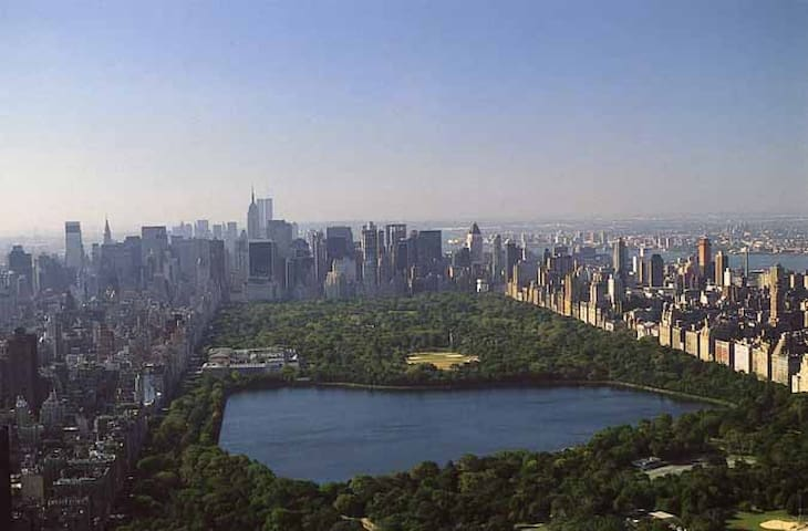 Helicopter view of Central Park North looking south;  Less than 2 miles, Less than 3 kilometers away.