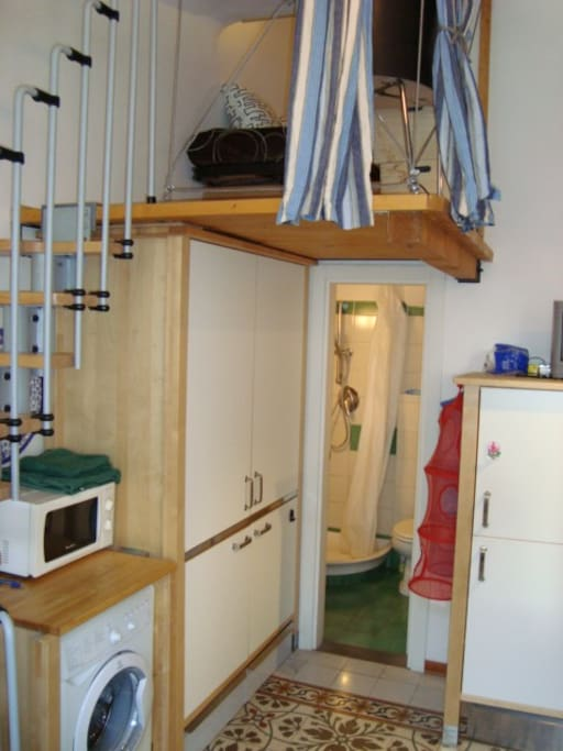 Balcony with little bedroom. Closed kitchenette