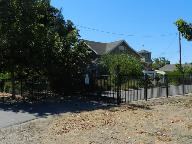 The property is securly gated and fenced with entrance keypad out front.