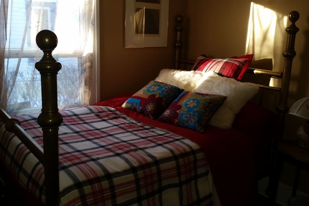 This is the bedroom - it is a brass bed with a very new mattress and boxspring.