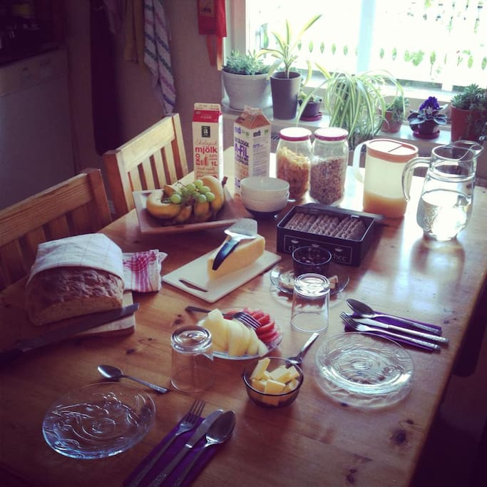 Breakfast with home-made bread, juice, coffee, tea, cereals, fresh fruit, eggs and much more.
