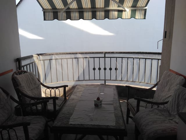 balcony 1 with dining table