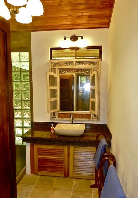 Bali Style bathroom with granite counter top