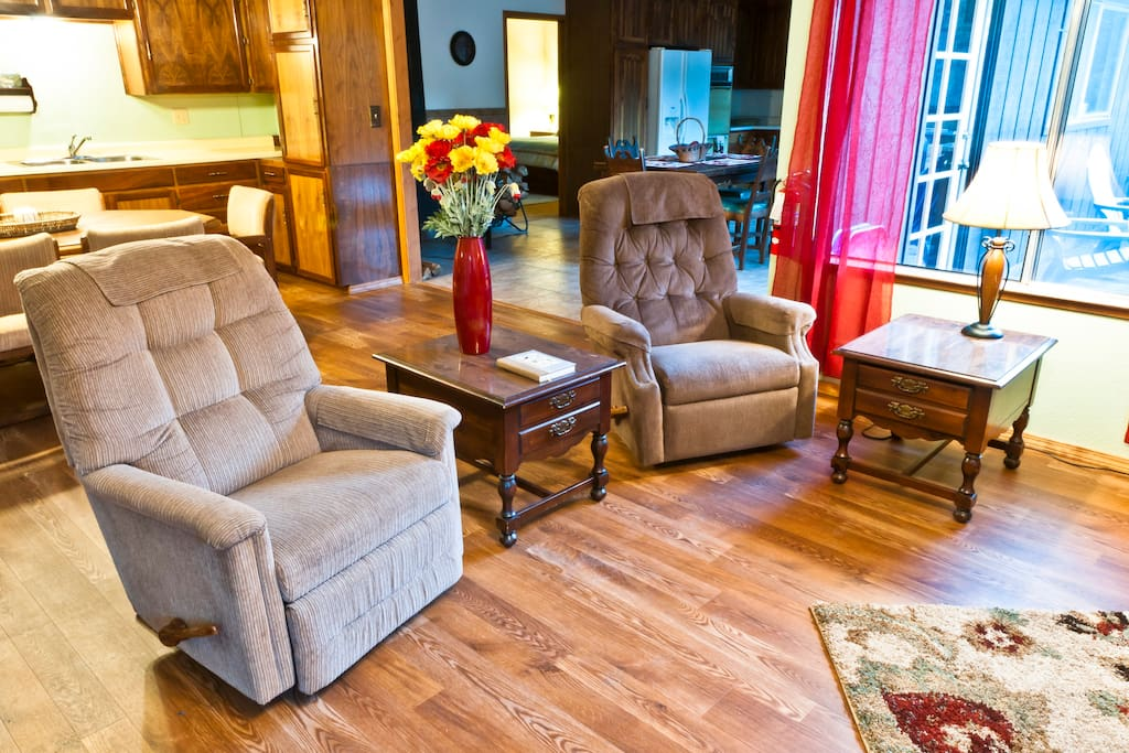 Two relaxing rocker recliners in living room.