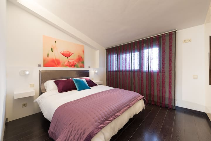 BEDROOM is furnished with a 150 cm king-size bed and a large built-in wardrobe.