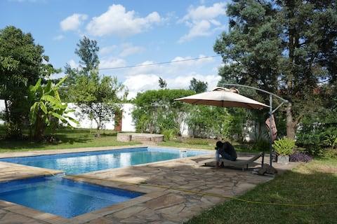 Nice room large garden and pool in Safari Area