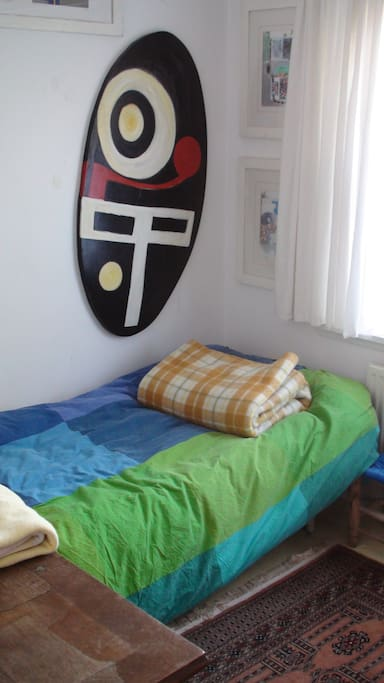 Small private room first floor, 1 single bed, backside of the house, washbin.