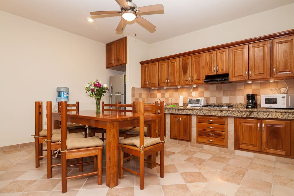 Fully equiped kitchen with granite countertop. Dining table seats eight.
