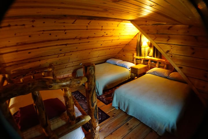 Open lofted with 2 full beds and a single bed.