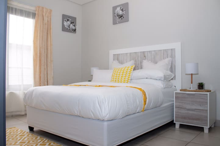 Comfortable bed with professional cleaned linen