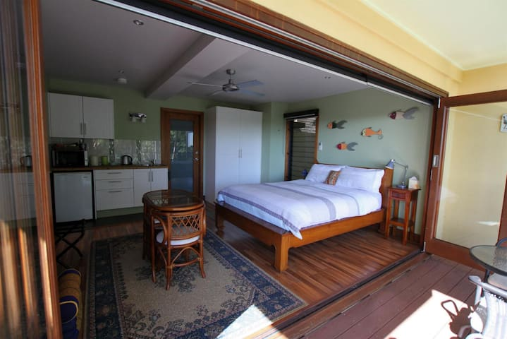 The guest suite has a kitchenette with sink, fridge, microwave, and all the breakfast essentials