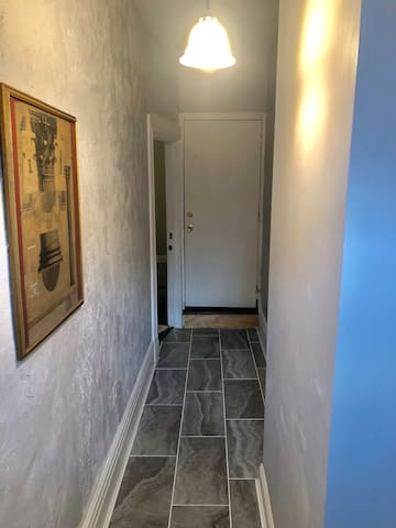 This house is a duplex. La Piccola Casa is the entrance on the 1st floor to the left in this photo.  Front hallway entering.