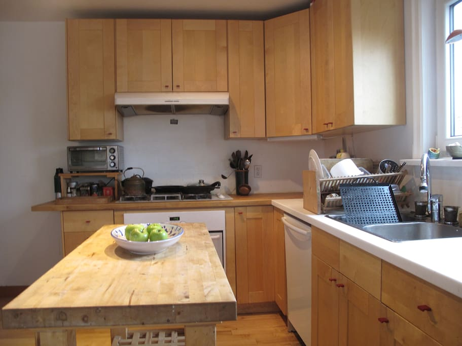 Lovely kitchen, with gas stove. Great place for cooking, eating, and hanging out. Back door goes to deck and into the large garden.