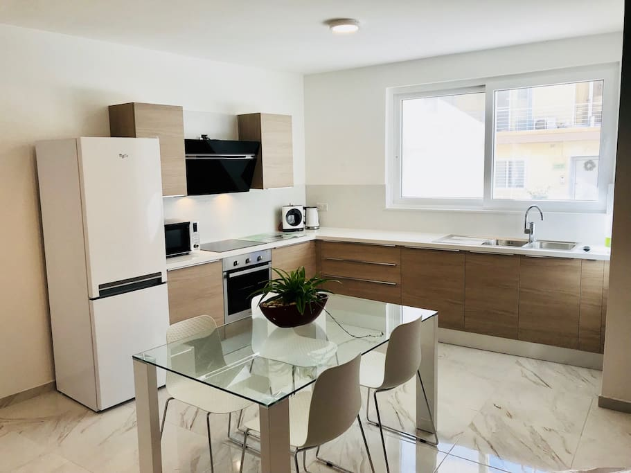 Fully equipped scavolini kitchen with marble top, induction hob, dishwasher, microwave, oven, kettle, Toaster and coffee maker. [Tea and coffee are also provided, just help yourself from the kitchen]