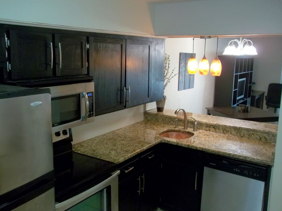 Granite countertops, copper sink and stainless appliances