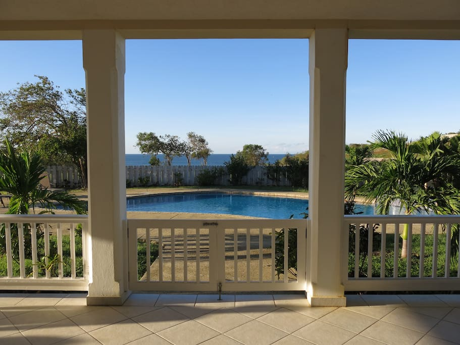 View of pool and ocean from back verandah