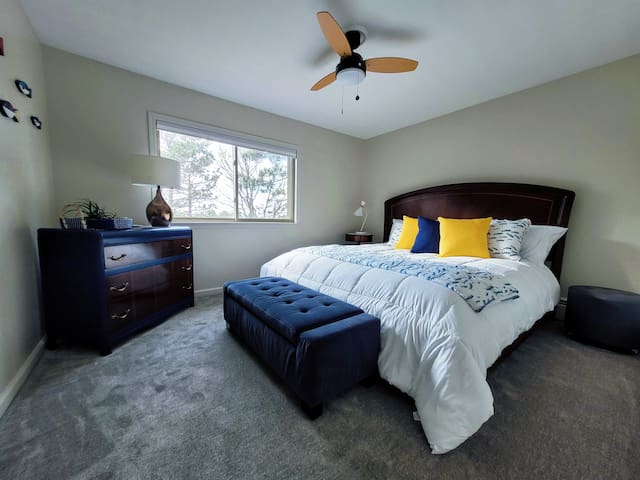 King Guest Room with windows overlooking the lake
