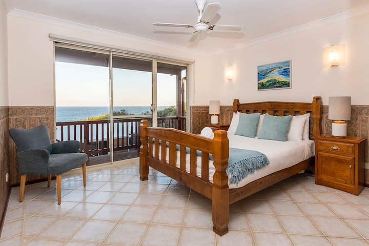 Upstairs master queen bedroom has shared balcony, walk in robe and ensuite with shower and toilet.