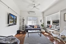 Comfortable lounge room with Smart TV and window seat