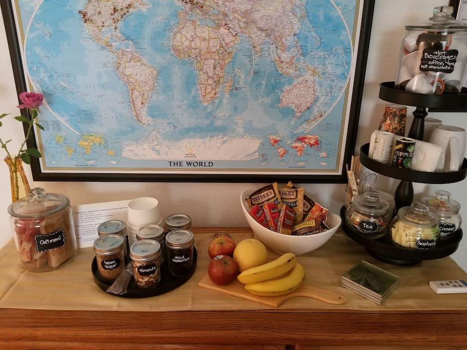 Oatmeal Bar with assorted toppings, Beverage Station, fruit & snacks