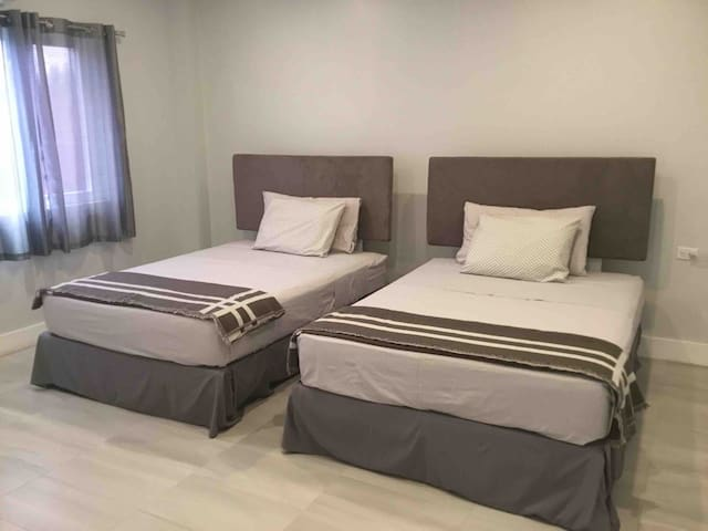 Second Bedroom with 2 double beds which can be joined as one upon request