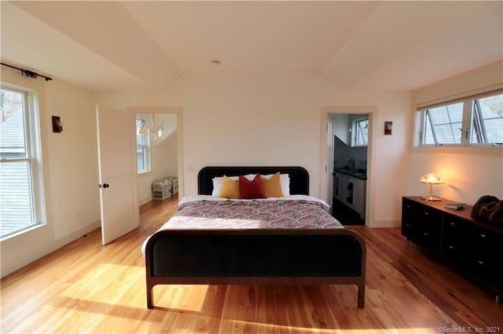 Master Bedroom - King Bed, Dresser, seating area, large closet, overlooking the garden.
