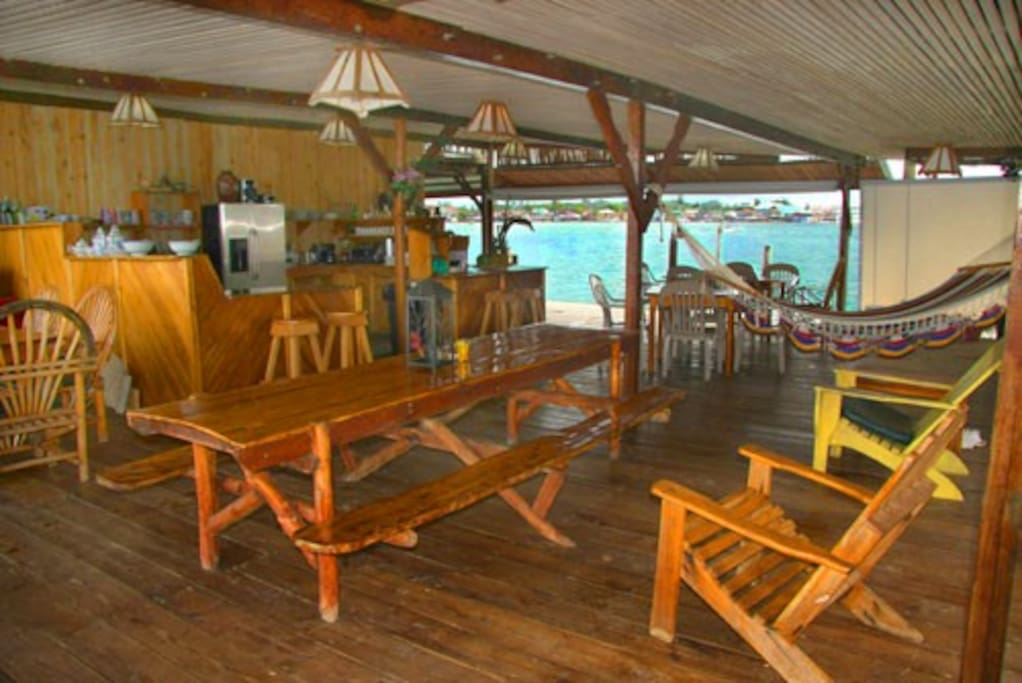 Leisure terrace and open air kitchen for guests to relax and commune