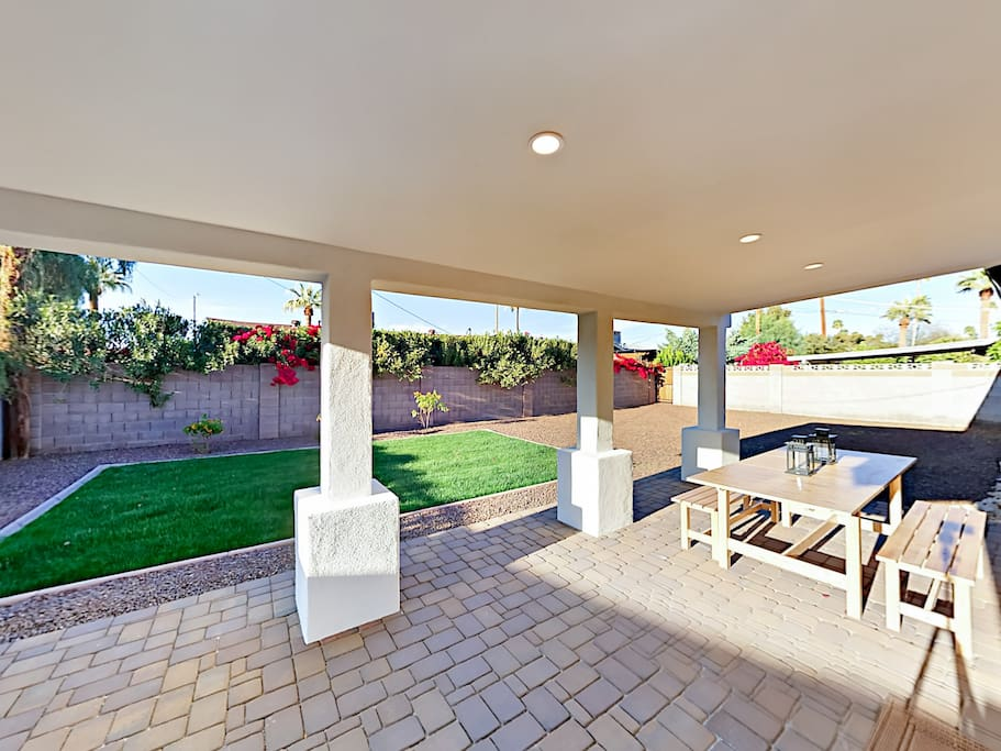 Entertain in the privacy of your fenced backyard, equipped with a covered patio, grill, and al fresco dining.