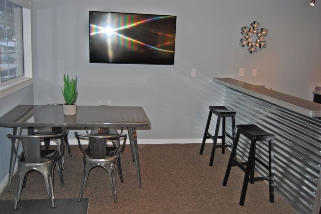 "Dinning area with 55"" Smart TV"
