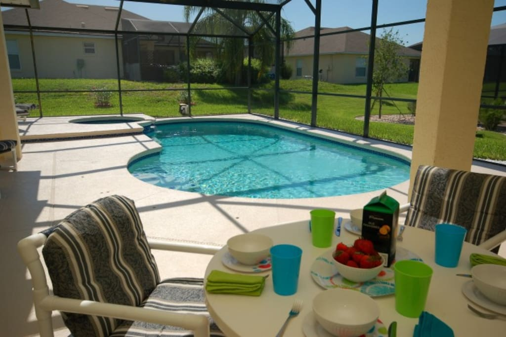 Relax and dine by the pool on your shaded lanai
