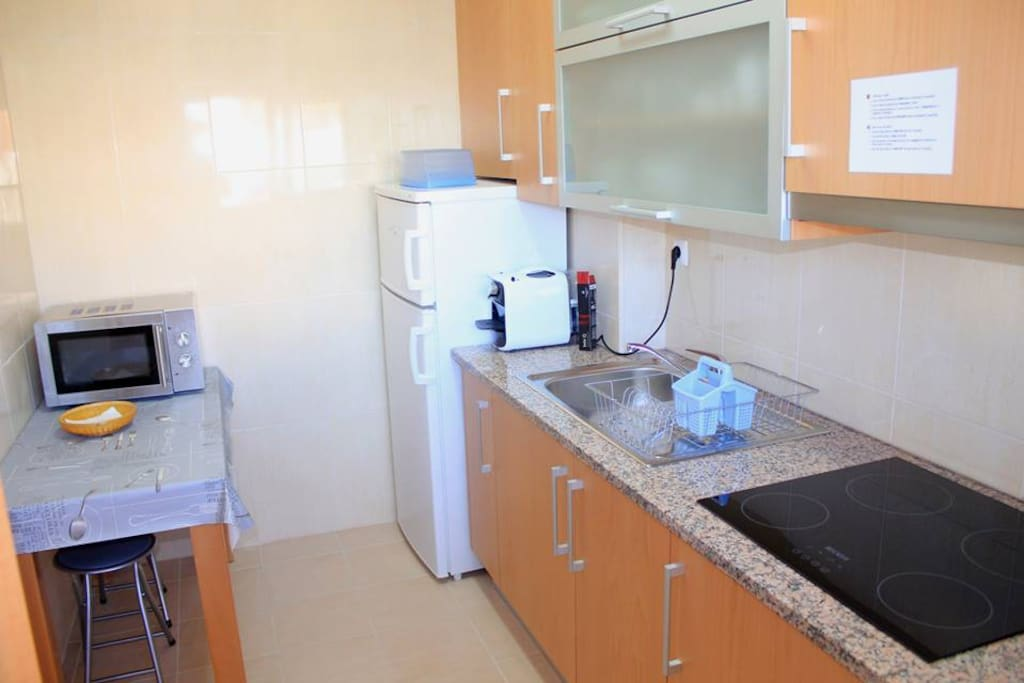 Kitchen fully equipped with cutlery, fridge, micro wave, coffee machine ...