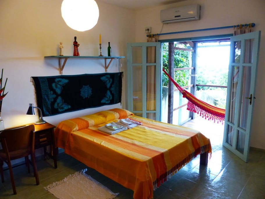 a cosy room with air-conditioning and a little varanda