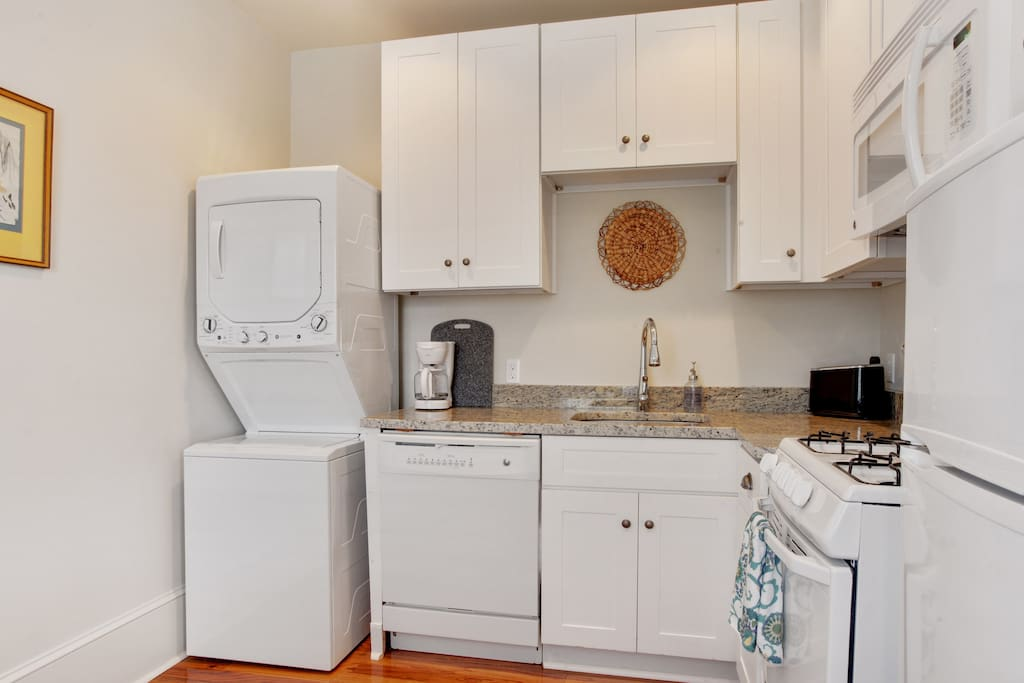 Kitchen is fully supplied and includes seating for 2. Washer and dryer for convenience.