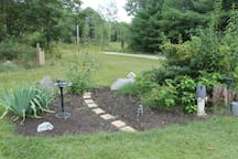 Sit on the patio behind the guesthouse and enoy perennial garden and views.