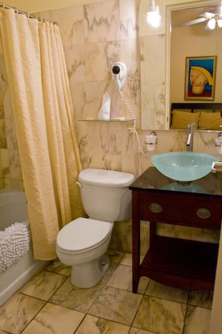 bathroom with basic amenities including a whirlpool tub, hairdryer, etc