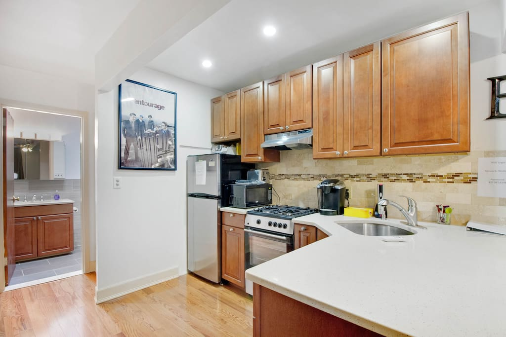 Full kitchen with stove, oven, and Keurig